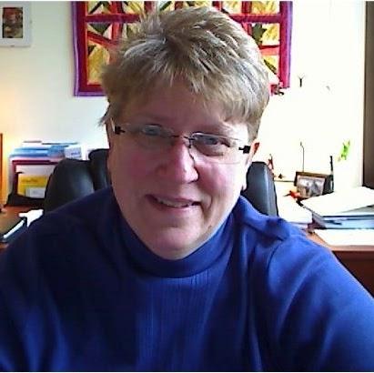 Headshot of Cindy Tananis.